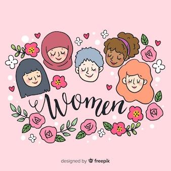 フラットデザインの女性の手描きの国際的なグループ