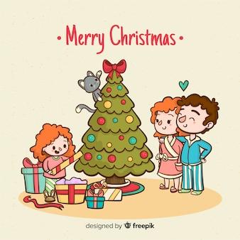 女の子がクリスマスの背景を開く