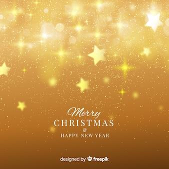 ぼんやりした星のクリスマスの背景
