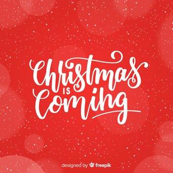 美しい赤いクリスマスレタリングの背景