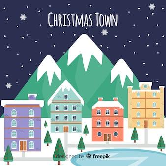 凍った湖の町のクリスマスの背景