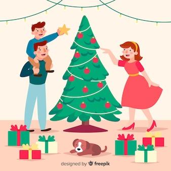 Семья, украшающая фон рождественская елка