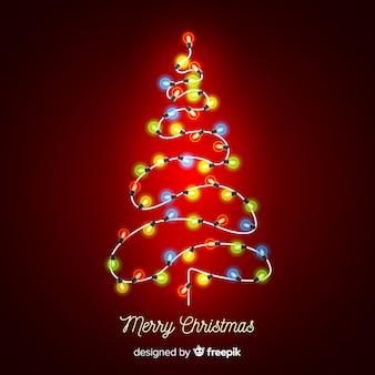 カラフルな光の花輪のクリスマスツリーの背景