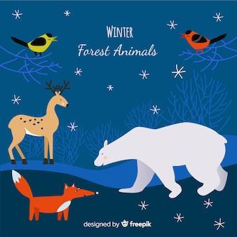 冬の手描きの森の動物の背景