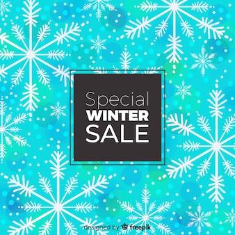 冬の販売の雪片の背景