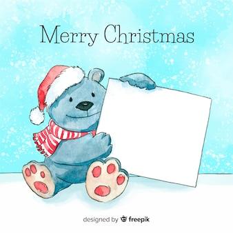 白い空のカードを保持するクリスマスの文字