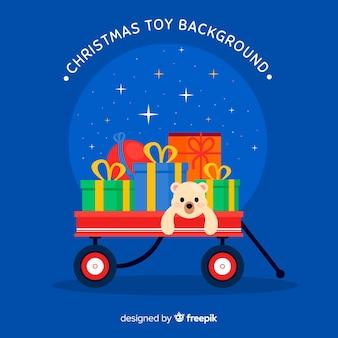 おもちゃのクリスマスの背景でいっぱいの手押し車