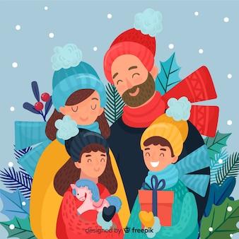 クリスマスを祝う幸せな手描きの家族