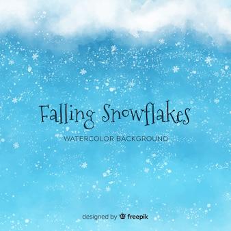 水色の雪片と冬の背景