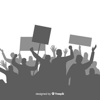 抗議する人々のシルエットと革命の構図