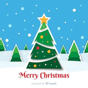紙のスタイルでクリスマスツリーの背景