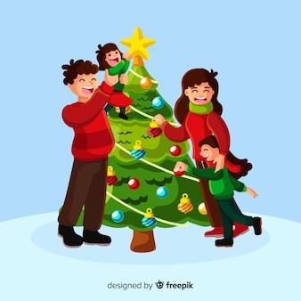 Счастливая семья, украшающая елку