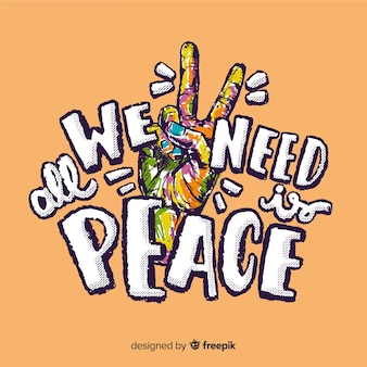 単語の背景とカラフルな手の平和サイン