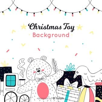 Рождественский фон с рисованной игрушкой