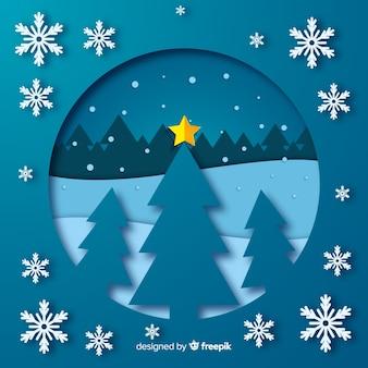 星と雪の背景のクリスマスツリー