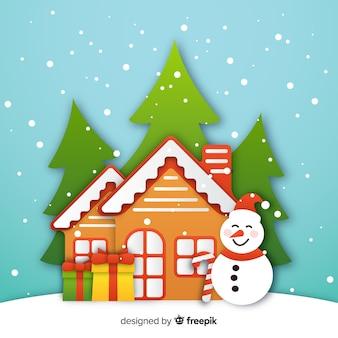 紙のスタイルで雪だるまとジンジャーブレッドの家