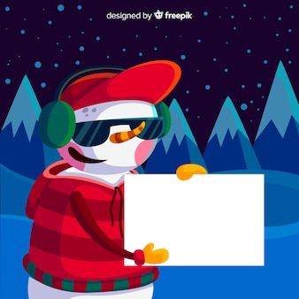 白い空のカードを保持するフラットクリスマスの文字
