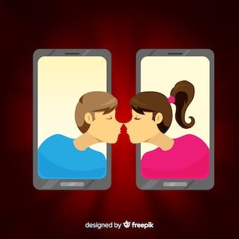 携帯電話のバレンタインデーの背景を通ってカップル
