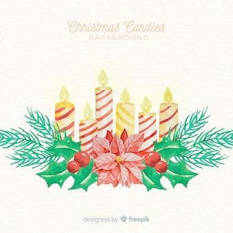 クリスマスキャンドルの水彩の背景