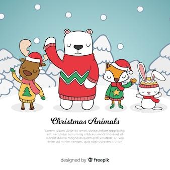 動物のクリスマスの背景を振る