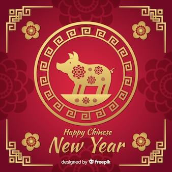 赤と黄金の中国の新年の背景