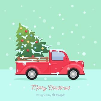 クリスマスツリーの配達トラックの背景