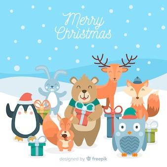 ギフトクリスマスの背景に動物を笑顔