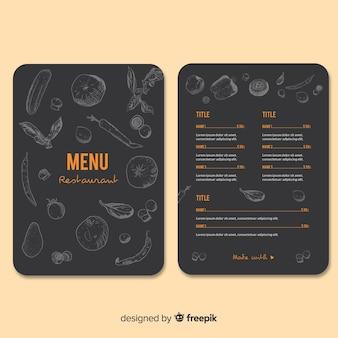 黒板レストランメニューテンプレートに描かれた食べ物を手します。