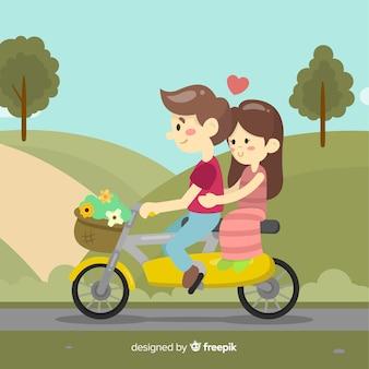 バイクに乗っているバレンタインの背景のカップル