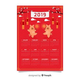 豚を踊る中国の新年カレンダー