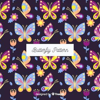 平らな蝶の背景
