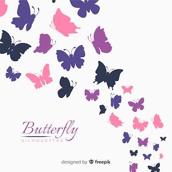 カラフルな蝶のシルエットの背景