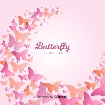 グラデーション蝶シルエットが飛んで