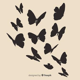 飛んでいる蝶のシルエット