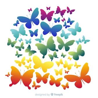 虹の群れ蝶シルエット背景