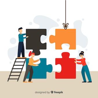 Люди, соединяющие кусочки головоломки