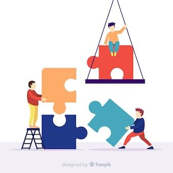 パズルのピースのカラフルな背景を接続する人々