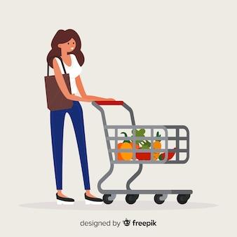 スーパーマーケットの背景で買い物をする女性