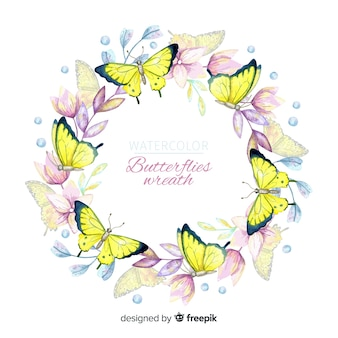 水彩画の蝶と花の花輪