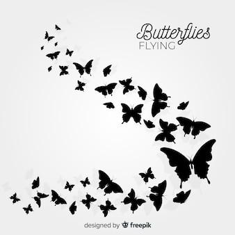 蝶の群れシルエット背景