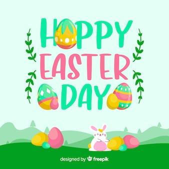 卵イースターの日の背景を持つフィールドに描かれたウサギを手します。