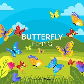 フィールドの背景を飛んでいる蝶