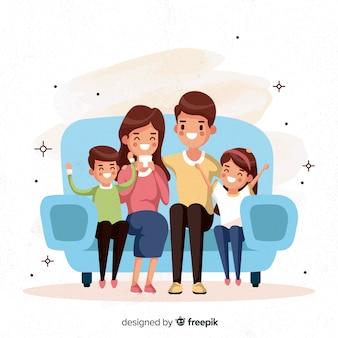 Ручной обращается семья сидит на фоне дивана