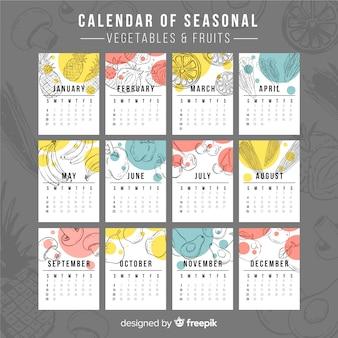 Ручной обращается сезонный календарь еды