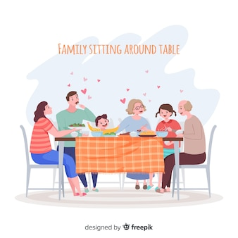 Семья сидит за столом