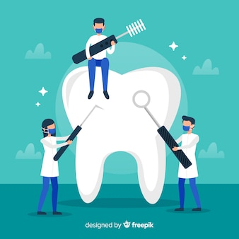 Стоматолог чистит большой зуб фон