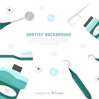平らな歯科医のツールの背景