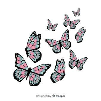 リアルなダブルトーンの蝶グループの飛行
