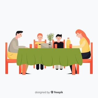 平らな家族が一緒に食べる