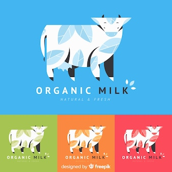 Корова с листьями органического молока логотип